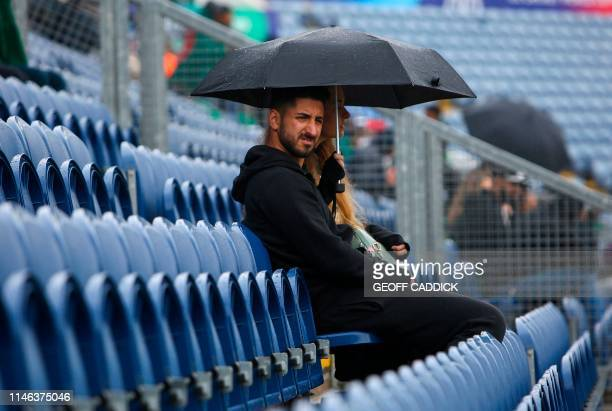 Pakistan fans wait in the rain as play is delayed in the 2019 Cricket World Cup warm up match between Pakistan and Bangladesh at Sophia Gardens...