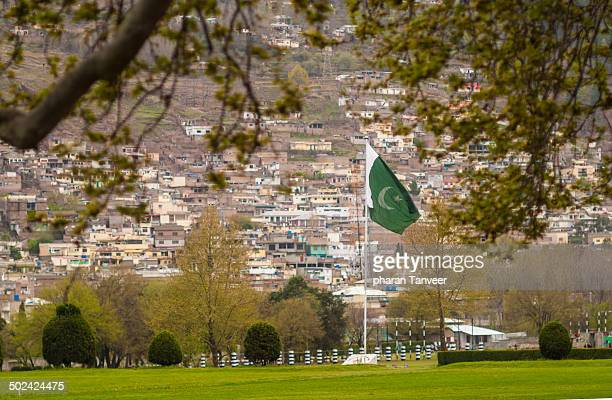 pakistan flag waves - pakistani flag stock photos and pictures