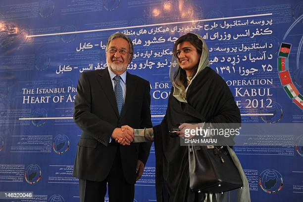 Pakistan Foreign Minister Hina Rabbani Khar shakes hands with her Afghan counterpart Zalmai Rasool before the start of the the Heart of Asia...