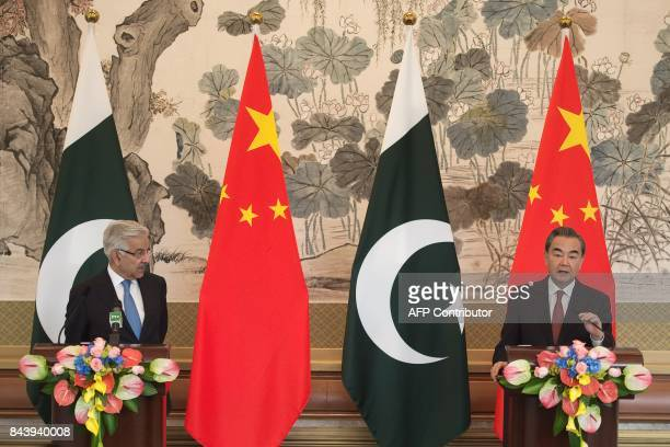 Pakistan Foreign Minister Khawaja Muhammad Asif and Chinese Foreign Minister Wang Yi speak during a press conference in Beijing on September 8 2017 /...