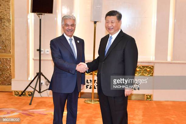 Pakistan Foreign Minister Khawaja Muhammad Asif shakes hands with Chinese President Xi jinping before a meeting at the Great Hall of the People in...
