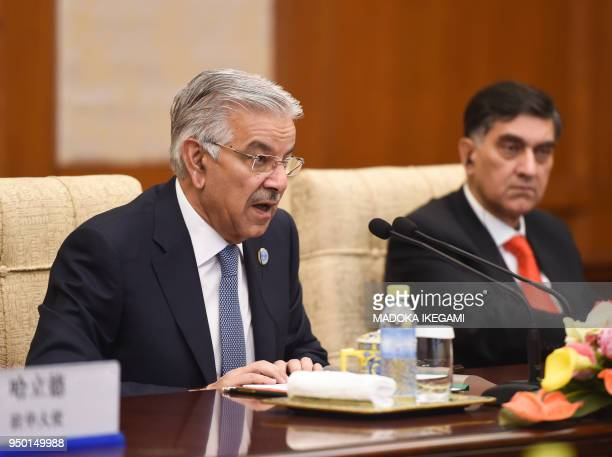 Pakistan Foreign Minister Khawaja Muhammad Asif speaks to Chinese State Councilor and Foreign Minister Wang Yi during their meeting at the Diaoyutai...