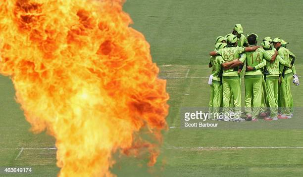 Pakistan form a huddle after taking an Indian wicket during the 2015 ICC Cricket World Cup match between India and Pakistan at Adelaide Oval on...