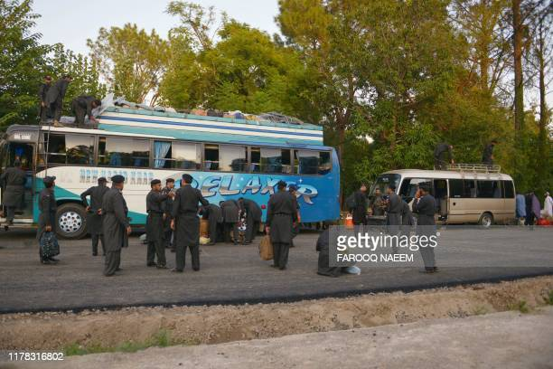 Pakistan Frontier Constable shift their belonging from a bus on their arrival in Islamabad on October 26 ahead of opposition party Jamiat UlemaeIslam...