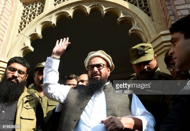 Pakistan head of the JamaatudDawa organisation Hafiz Saeed waves to supporters as he leaves a court in Lahore on November 21 2017 Saeed designated a...