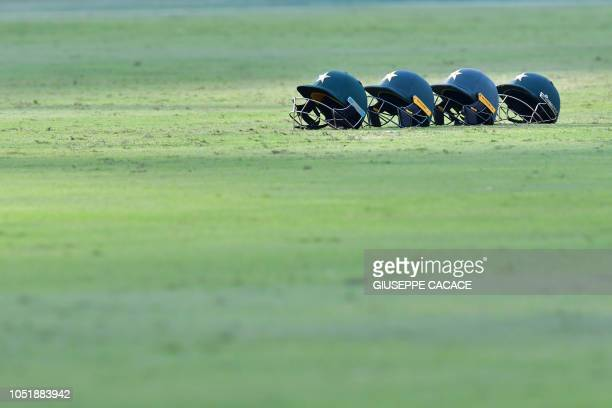 TOPSHOT Pakistan helmets are pictured during day five of the first Test cricket match in the series between Australia and Pakistan at the Dubai...