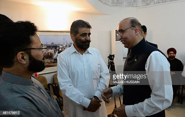 Pakistan high commissioner to India Abdul Basit talks with senior seperatist leader Nayeem Khan at a function to celebrate Eid Milan at the Pakistani...