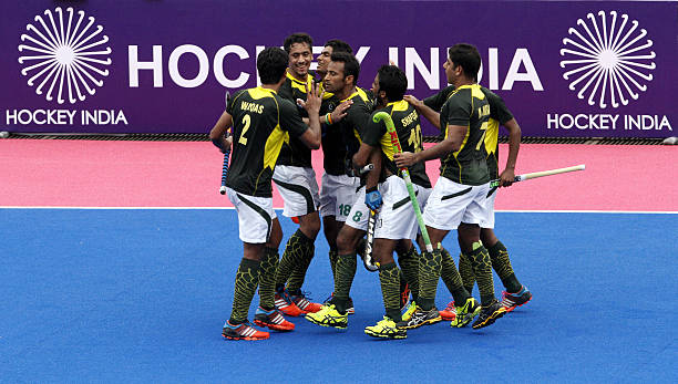 5c9d93fd5fc Pakistan hockey player Muhammad Irfan (Green Jersey 8) celebrates with team  mates after scoring