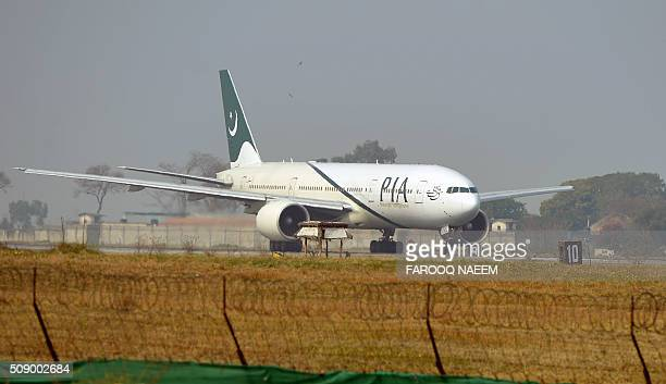 A Pakistan International Airline plane taxis on the runway on the way to Saudi Arabia during the PIA employees strike in Islamabad on February 8 2016...