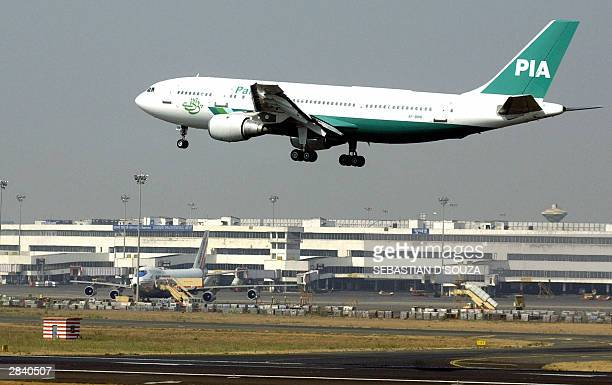 Pakistan International Airlines aircraft comes in to land at Bombay International Airport 02 January 2004 following the first flight from Karachi...