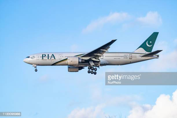 PIA Pakistan International Airlines Boeing 777200 wide body airplane with two GE90 engines and registration APBHX landing at London Heathrow...