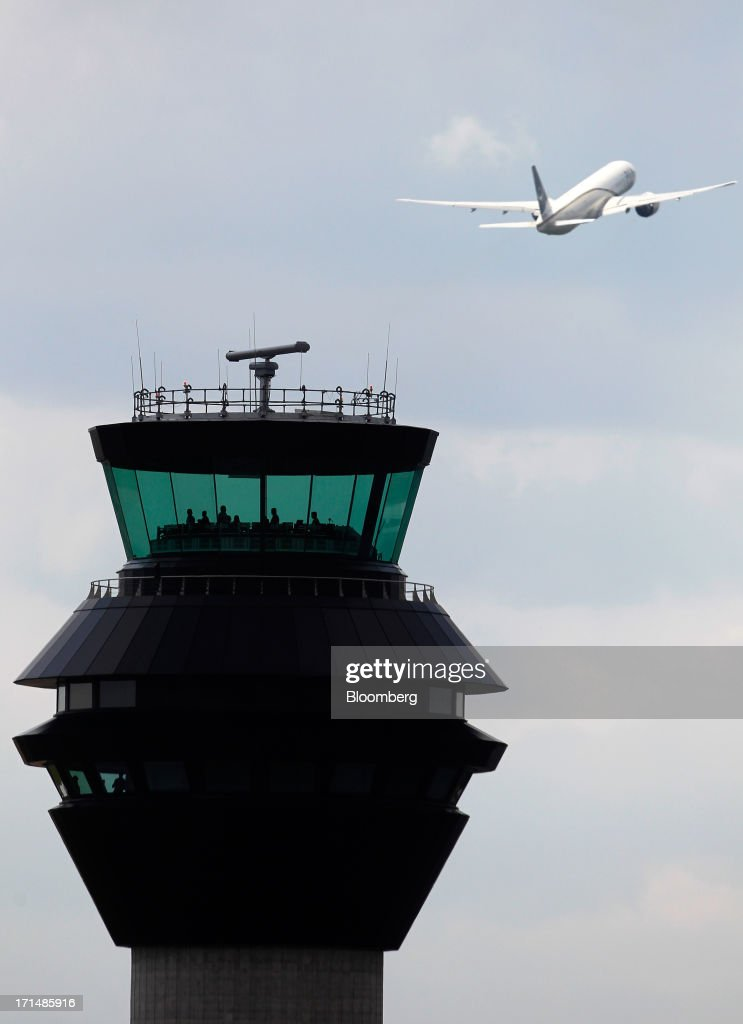 A Pakistan International Airlines (PIA) Corp. aircraft takes off near the new control tower at Manchester Airport, operated by Manchester Airports Group (MAG), in Manchester, U.K., on Tuesday, June 25, 2013. Manchester, which also runs London Stansted, East Midlands and Bournemouth airports, is served by 10 foreign long-haul carriers and is the only terminal in Britain outside Heathrow used by Airbus's A380 superjumbo, the world's biggest jetliner. Photographer: Paul Thomas/Bloomberg via Getty Images