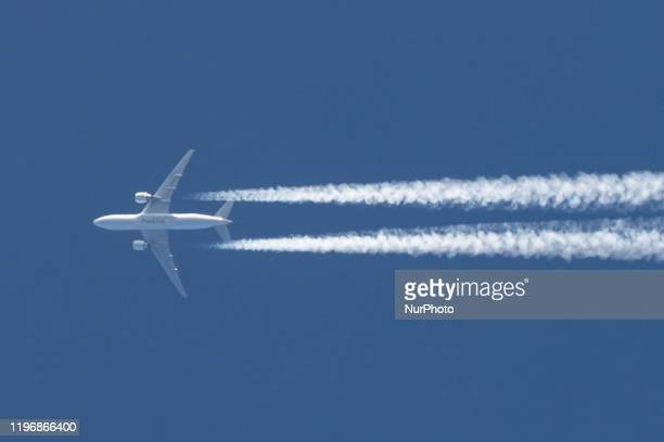Pakistan International Airlines PIA Boeing 777 commercial aircraft overfly in the blue sky over Europe in Brabant Netherlands on 26 January 2020 The...