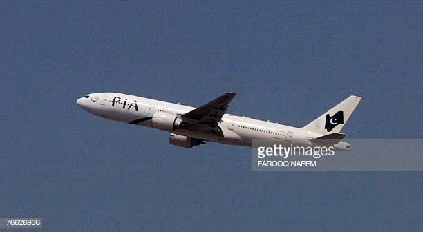 A Pakistan International Airlines plane carrying former prime minister Nawaz Sharif takes off from the Islamabad airport 10 September 2007 Pakistan...