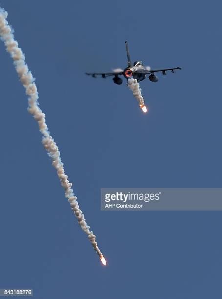 A Pakistan jet fighter drops flares during celebrations to mark Defence Day at the Nur Khan military airbase in Islamabad on September 6 2017...