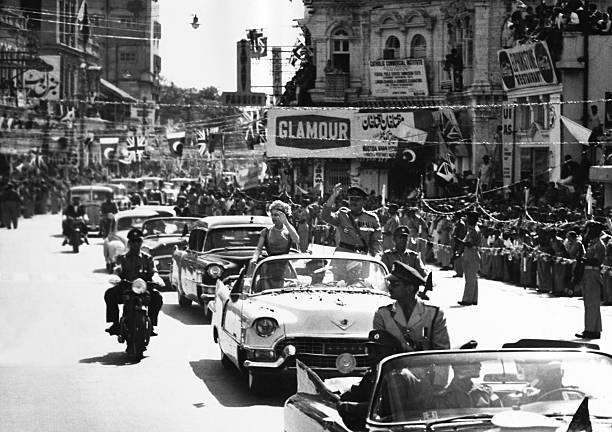 Pakistan, Karachi. Hm The Queen Elizabeth Ii And Marshall Ayub Khan Wave At The Crowd In February 1961.