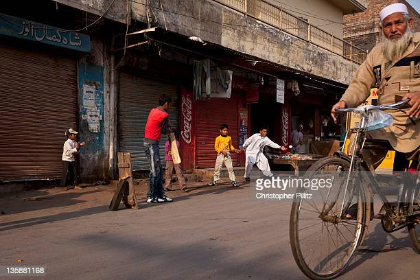 Pakistan - Kids playing cricket on city streets