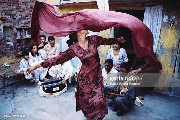 Pakistan, Lahore, people watching hijra dancing