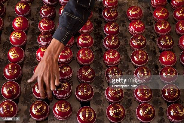 Cricket bat and ball factory, Sialcot, Pakistan. Seen here polishing hand made balls. This company make the bats for the Pakistan National Cricket...