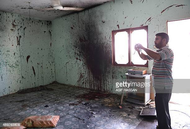 A Pakistan man takes pictures in a room where a suicider blew himself up in Karachi on September 20 2015 A suicide bomber attacked Pakistani police...