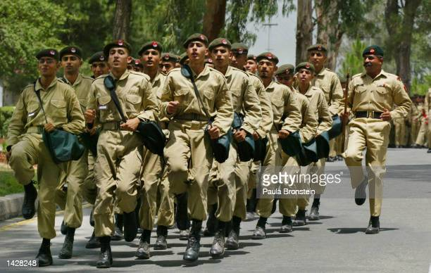 Pakistan military cadets train with their weapons during parade practice July 3 2002 at the Pakistan Military Academy in Abbottabad Pakistan There...