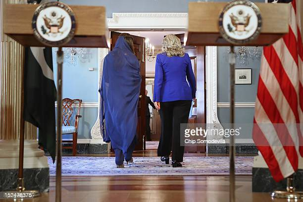 Pakistan Minister of Foreign Affairs Hina Rabbani Khar and US Secretary of State Hillary Clinton walk away after making brief statements in the...