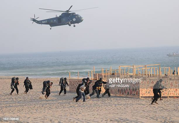 Pakistan Navy special forces present an impressive Maritime counter terrorism demonstration during the Multinational exercise AMAN13 in Manora island...