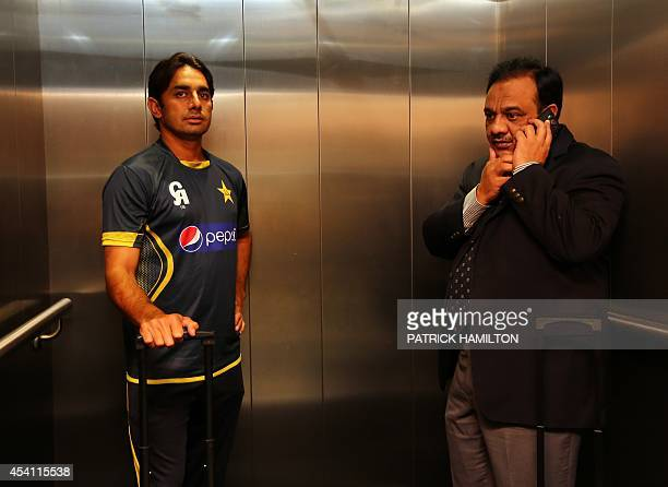 Pakistan offspinner Saeed Ajmal arrives with a Pakistan official at the Australian National Cricket Centre Brisbane on August 25 2014 Underscrutiny...