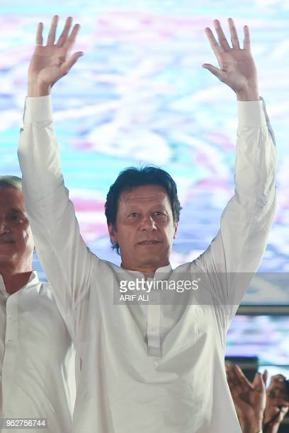 Pakistan opposition leader and leader of the Pakistani political party Pakistan TehreekeInsaf Imran Khan waves at his supporters during a political...