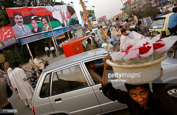 Pakistan People's Party billboard featuring Benazir Bhutto sits above a busy intersection on November 8 2007 in Rawalpindi Pakistan Bhutto plans to...