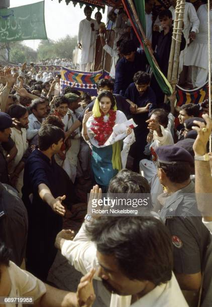 Pakistan People's Party candidate Benazir Bhutto greets a crowd of supporters following a campaign speech on November 1, 1988 in the Punjab province...