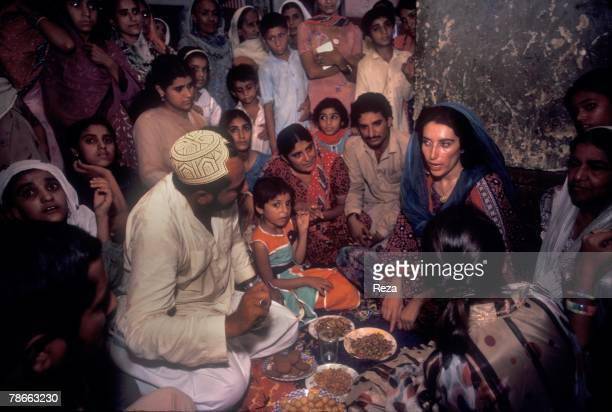 Pakistan People's Party candidate Benazir Bhutto visits families whose members had been murdered during the rule of current President General...