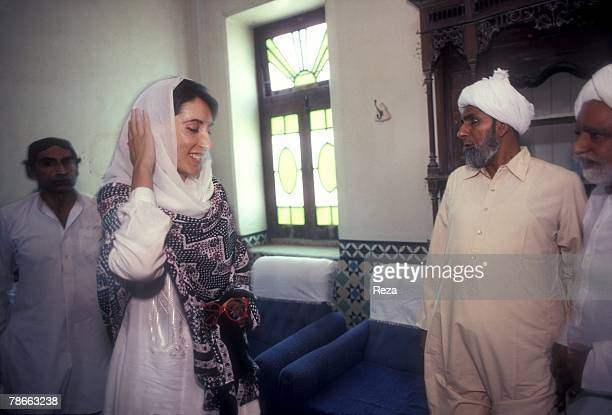 Pakistan People's Party candidate Benazir Bhutto visits the elders in Sindh province after returning from exile to begin her election campaign...