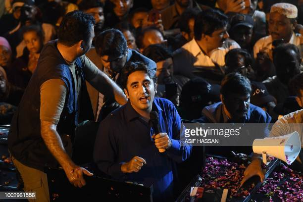 Pakistan Peoples Party Chairman Bilawal Bhutto speaks to supporters during an election campaign rally in Karachi early on July 21 2018 Pakistan will...