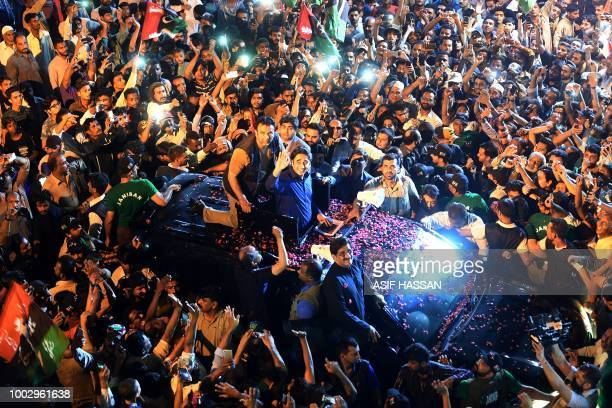 Pakistan Peoples Party Chairman Bilawal Bhutto waves to supporters during an election campaign rally in Karachi early on July 21 2018 Pakistan will...