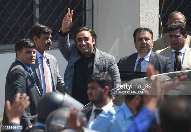 Pakistan Peoples Party chairman Bilawal Bhutto Zardari waves to supporters as he arrives in the National Accountability Bureau in Islamabad on March...