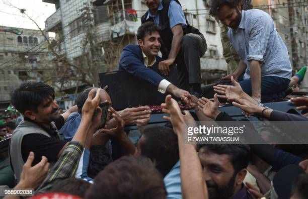 Pakistan Peoples Party chairperson Bilawal Bhutto Zardari meets with supporters during an election campaign in Karachi on July 1 2018 Pakistan's...