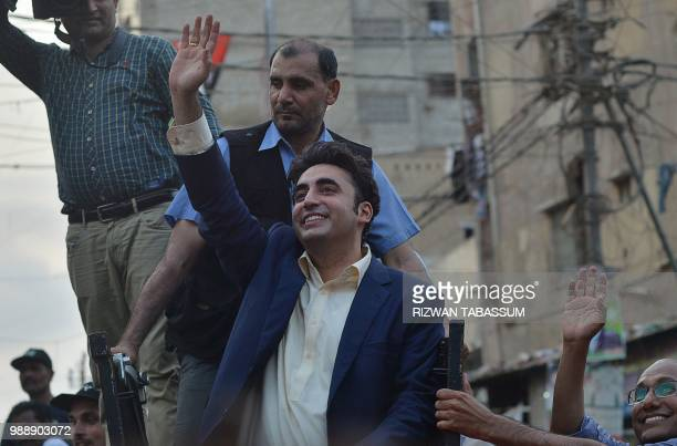 Pakistan Peoples Party chairperson Bilawal Bhutto Zardari waves to supporters during an election campaign in Karachi on July 1 2018 Pakistan's...