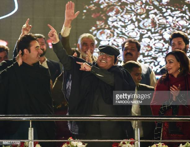 Pakistan Peoples Party Cochairperson Asif Ali Zardari and his son Chairperson Bilawal Bhutto Zardari take part in a rally to mark the party's 50th...