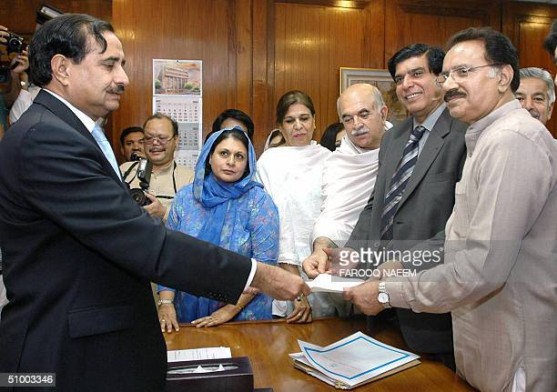 Pakistan People's Party leader Amin Fahim files his nomination papers to the Secretary of the National Assembly Mahmood Salim Chaudry for the post of...