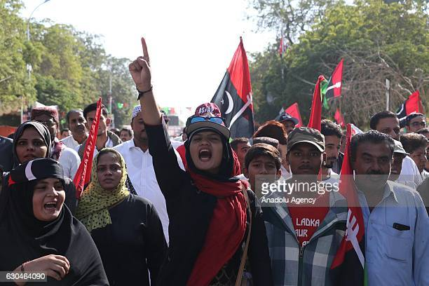 Pakistan Peoples Party supporters shout slogans at Karachi Old Terminal to welcome their leader Asif Ali Zardarion in Karachi Pakistan on December 23...