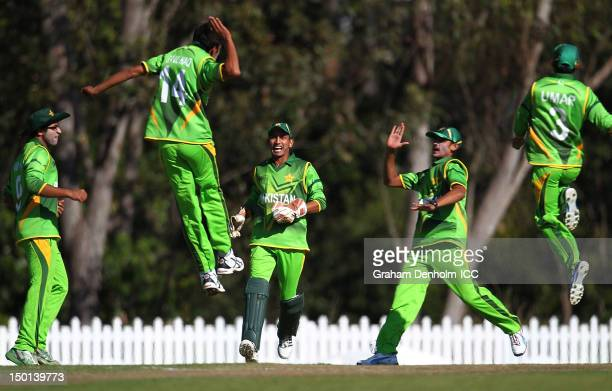 Pakistan players celebrate during the ICC U19 Cricket World Cup 2012 match between Pakistan and Afghanistan at John Blanck Oval on August 11, 2012 in...