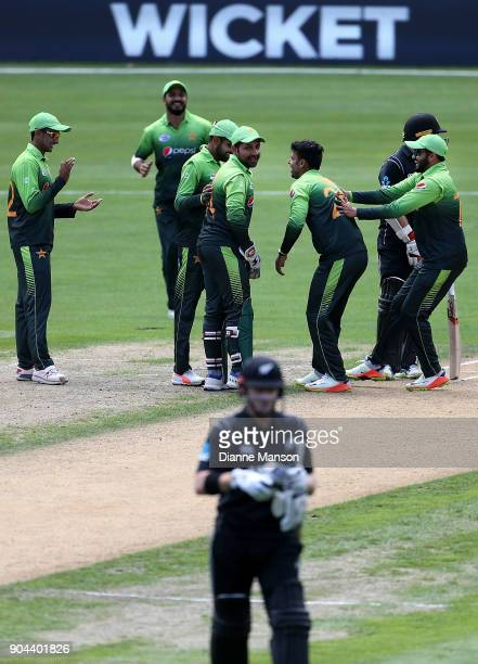 Pakistan players celebrate the dismissal of Henry Nicholls of New Zealand during the third game of the One Day International Series between New...