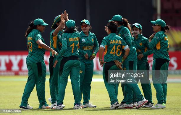 Pakistan players celebrate the wicket of Smriti Mandhana of India during the ICC Women's World T20 2018 match between India and Pakistan at Guyana...