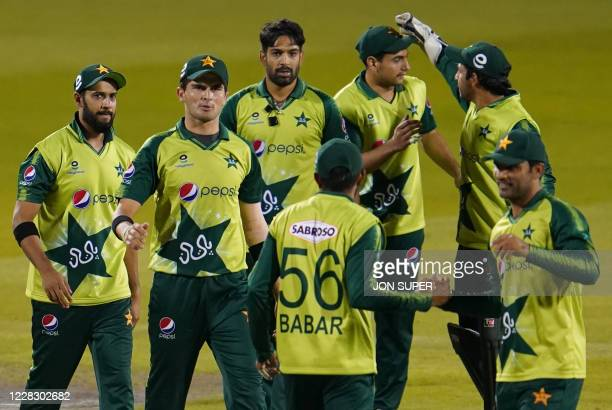 Pakistan players celebrate winning by five runs after the international Twenty20 cricket match between England and Pakistan at Old Trafford cricket...