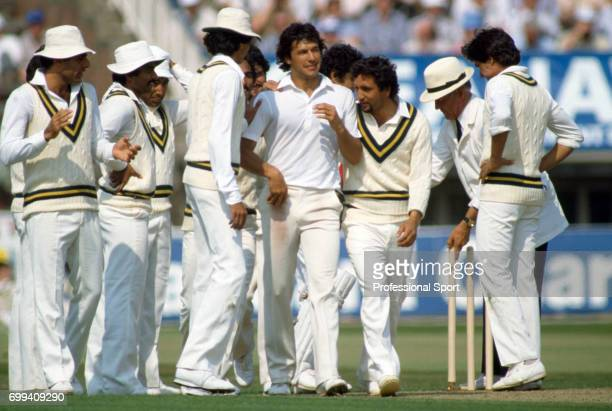 Pakistan players congratulate their captain Imran Khan on another England wicket during the 1st Test match between England and Pakistan at Edgbaston...