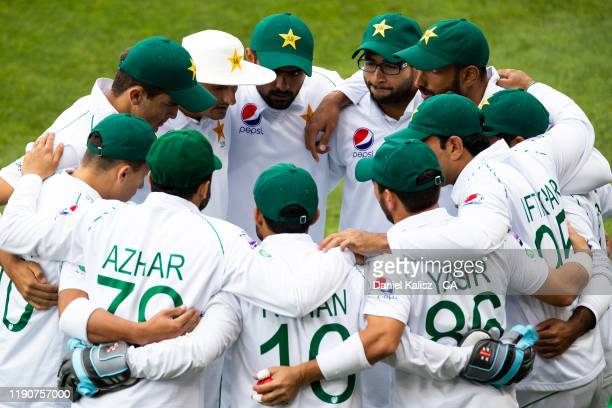 Pakistan players form a huddle during day one of the 2nd Domain Test between Australia and Pakistan at Adelaide Oval on November 29, 2019 in...
