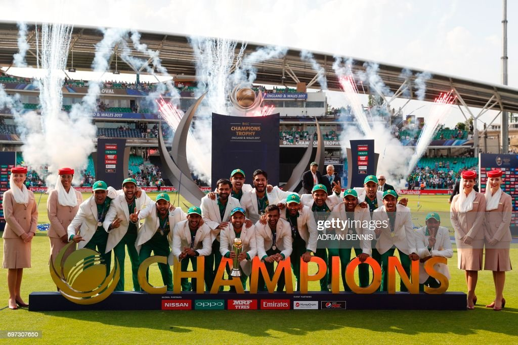 TOPSHOT - Pakistan players pose with the trophy as they celebrate their win at the presentation after the ICC Champions Trophy final cricket match between India and Pakistan at The Oval in London on June 18, 2017. Pakistan thrashed title-holders India by 180 runs to win the Champions Trophy final at The Oval on Sunday. PHOTO / Adrian DENNIS / RESTRICTED