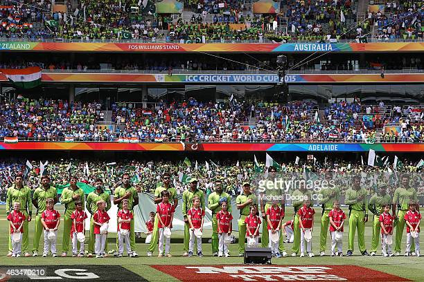 Pakistan players stand for the national anthem during the 2015 ICC Cricket World Cup match between India and Pakistan at Adelaide Oval on February 15...