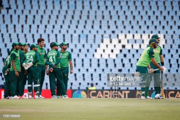 Pakistan players wait for a review decision of the dismissal of South Africa's Aiden Markram during the third one-day international cricket match...